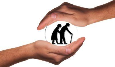 Socijalni fond - briga za starije i nemoćne. Male siluete dvije starije osobe, jedna sa štapom, a između njih dvije ruke koje ih štite